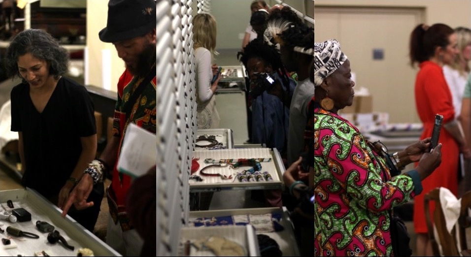 People examining the South African Collection in a museum