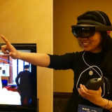 Qian wearing VR googles